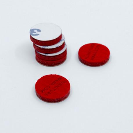Röda självhäftande möbeltassar